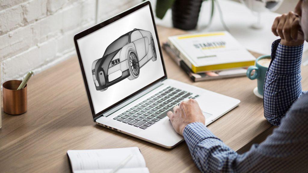 En person sitter och designar en 3D-modell av en bil genom CAD